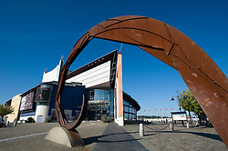 Exterior view of Gothenburg Opera House and abstract steel sculpture in Sweden