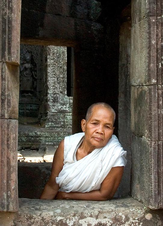 Woman in a window, Bayon temple, Angkor, Cambodia