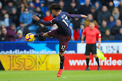Arsenal's Alex Iwobi scores his side's first goal of the game during the Premier League match at the John Smith's Stadium, Huddersfield.