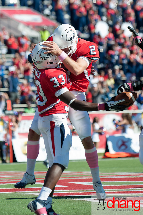 MOBILE, AL - OCTOBER 20:  Running back Demetre Baker #33 of the South Alabama Jaguars celebrates with quarterback Ross Metheny #2 of the South Alabama Jaguars after scoring a touchdown while playing against the Florida Atlantic Owls on October 20, 2012 at Ladd-Peebles Stadium in Mobile, Alabama. South Alabama defeated Florida Atlantic in the second overtime 37-34.  (Photo by Michael Chang/Getty Images) *** Local Caption *** Demetre Baker;Ross Metheny