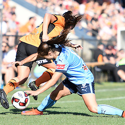 BRISBANE, AUSTRALIA - OCTOBER 30: Servet Uzunlar of Sydney tackles Angela Beard of the Roar during the round 1 Westfield W-League match between the Brisbane Roar and Sydney FC at Spencer Park on November 5, 2016 in Brisbane, Australia. (Photo by Patrick Kearney/Brisbane Roar)
