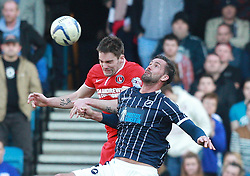 Millwall's Stefan Maierhofer battles for the high ball with Charlton Athletic's Dorian Dervite - Photo mandatory by-line: Robin White/JMP - Tel: Mobile: 07966 386802 15/03/2014 - SPORT - FOOTBALL - The Den - Millwall - Millwall v Charlton Athletic - Sky Bet Championship
