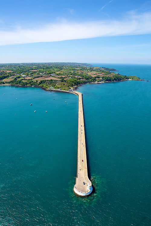 Aerial view of the walkway along St Catherine's breakwater on a sunny summer day in Jersey, C.I.