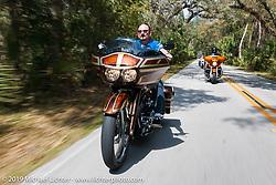 Brian Klock riding one of his custom dressers through Tomoka State Park during Daytona Bike Week. FL, USA. March 11, 2014.  Photography ©2014 Michael Lichter.