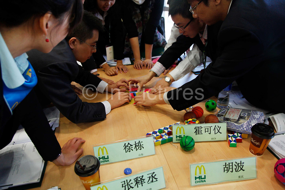 Students work together to put together a puzzle during a management training class at the McDonalds Hamburger University in Shanghai, China on Thursday, 13 january 2011. McDonalds claim that the university's selection criteria is even more stringent than that of Harvard.