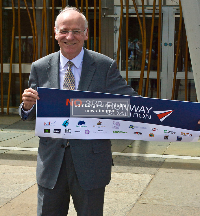 Pictured: Neil Gil Paterson, Regional MSP for the West of Scotland <br /> <br /> The No 3rd Runway Coalition was at the Scottish Parliament today to urge the SNP to change their position on supporting the Heathrow third runway proposal and to send the UK Government a message to 'think again'. Campaigners will be joined by MSPs from Scottish Greens, and SNP to highlight the environmental damage to Scotland and the rest of the UK that building a third runway would mean, as well as the fact that Scottish airports would suffer as a result.  Campaigners also believe that the SNP appear to be too trusting of UK Government promises – particularly in relation to the impact on Climate Change commitments - as revealed by Keith Brown, Cabinet Secretary for Economy, Jobs and Fair Work, in response to a question from Patrick Harvie MSP in the Scottish Parliament last Thursday.<br /> <br /> The Labour party announced their formal opposition to the proposal on Wednesday, on the basis that the UK Government's Airports National Policy Statement failed all four of party's tests on climate change, delivering extra capacity, air pollution and benefits to be felt outside of London. Additionally, the long-awaited UK Government mitigation framework for international aviation emissions won't be published for many months after MPs have been asked to support the Heathrow proposal. A recent report by the New Economics Foundation seriously calls into question the economic case – using the Department for Transport's own measures; and this is before taking into account the economic impact of Brexit <br /> <br /> <br /> <br /> Ger Harley   EEm 21 June 2018