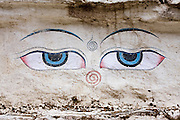 The eyes of the Buddha painted on a stupa (Buddhist shrine) built along the trail to Everest beyond Tengboche, Khumbu region, Sagarmatha National Park, Himalaya Mountains, Nepal.