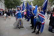 On the day that Parliament was suspended for five weeks, anti-Brexit protesters wave European Union flags outside the Cabinet Office in Westminster as inside Tory ministers gather on 10th September 2019 in London, England, United Kingdom.