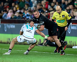 Ospreys' Hanno Dirksen is tackled by Connacht's Tiernan O'Halloran<br /> <br /> Photographer Simon King/Replay Images<br /> <br /> Guinness PRO14 Round 19 - Ospreys v Connacht - Friday 6th April 2018 - Liberty Stadium - Swansea<br /> <br /> World Copyright © Replay Images . All rights reserved. info@replayimages.co.uk - http://replayimages.co.uk