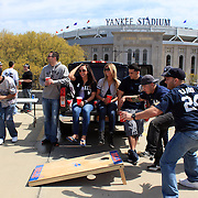 Yankee fans play in a car park overlooking Yankee stadium before the New York Yankees V Los Angeles Angels Baseball game at Yankee Stadium, The Bronx, New York. 15th March 2012. Photo Tim Clayton
