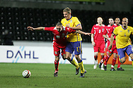Andrew Crofts of Wales (16) is tackled by Pontus Wernbloom of Sweden. .International friendly, Wales v Sweden at the Liberty Stadium in Swansea on Wed 3rd March 2010. pic  by  Andrew Orchard