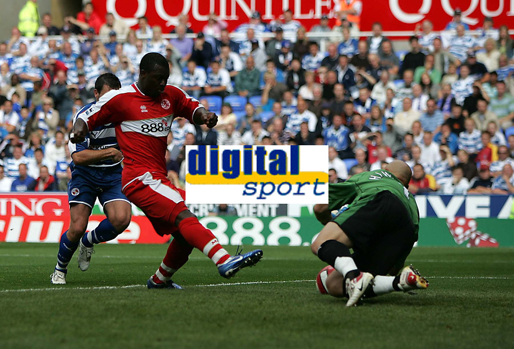 Photo: Lee Earle.<br /> Reading v Middlesbrough. The Barclays Premiership. 19/08/2006. Middlesbrough's Yakubu beats Reading keeper Marcus Hahnemann to score their second.