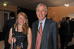 LADY FLORA CURZON and her father the 7th EARL HOWE at a preview evening of the annual London LAPADA (The Association of Art & Antiques Dealers) antiques Fair held in Berkeley Square, London on 20th September 2011.