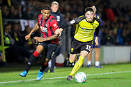 Bournemouth midfielder Jordon Ibe and  Burton Albion defender Reece Hutchinson challenge for the ball during the EFL Cup match between Burton Albion and Bournemouth at the Pirelli Stadium, Burton upon Trent, England on 25 September 2019.