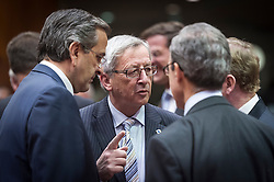 Jean-Claude Juncker, Luxembourg's prime minister, center, speaks with Antonis Samaras, Greece's prime minister, left, and Enda Kenny, Ireland's prime minister, right, during the first day of the EU Summit, at the European Council headquarters in Brussels, Belgium on Thursday, Dec. 13, 2012. (Photo © Jock Fistick)
