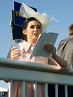 Grand National Meeting - Ladies' Day<br /> e.g. of caption:<br /> National Hunt Horse Racing - 2017 Randox Grand National Festival - Friday, Day Two [Ladies' Day]<br /> <br />   <br /> female racegoers studies the card in the 7th race Weatherbys Private Bank Standard Open NH Flat Race (Grade 2) (Class 1)2m 209y, Good<br /> 19 Runners.at Aintree Racecourse.<br /> <br /> COLORSPORT/WINSTON BYNORTH