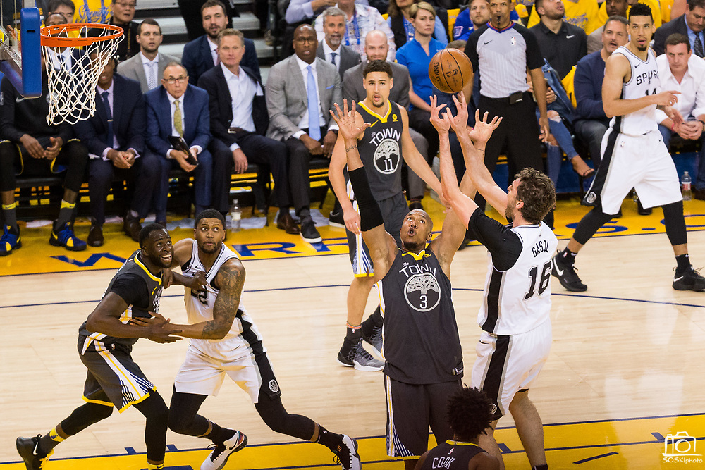 Golden State Warriors forward David West (3) defends San Antonio Spurs center Pau Gasol (16) during Game 2 of the Western Conference Quarterfinals at Oracle Arena in Oakland, Calif., on April 16, 2018. (Stan Olszewski/Special to S.F. Examiner)