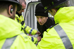 "© Licensed to London News Pictures . 21/03/2015 . Newcastle , UK . A man is arrested for Incitement to Racial Hatred . Neo-Nazis and skinheads from across Europe organise a "" White Man March "" in Newcastle , under the banner of "" National Action "" , opposed by "" North-East Anti-Fascists "" . Photo credit : Joel Goodman/LNP"