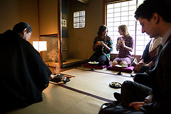 First Lady Michelle Obama participates in a traditional tea ceremony with Amb. Caroline Kennedy, U.S. Ambassador to Japan and her son Jack Schlossberg at the Kiyomizu-dera Buddhist temple in Kyoto, Japan, March 20, 2015.(Official White House Photo by Amanda Lucidon)<br /> <br /> This official White House photograph is being made available only for publication by news organizations and/or for personal use printing by the subject(s) of the photograph. The photograph may not be manipulated in any way and may not be used in commercial or political materials, advertisements, emails, products, promotions that in any way suggests approval or endorsement of the President, the First Family, or the White House.