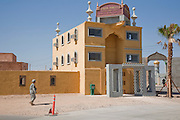 A soldier walks towards the Lyndon Marcus International Hotel in Medina Wasl, a fabricated Iraqi town at Camp Irwin, California. The village is used for training soldiers deploying to Iraq.