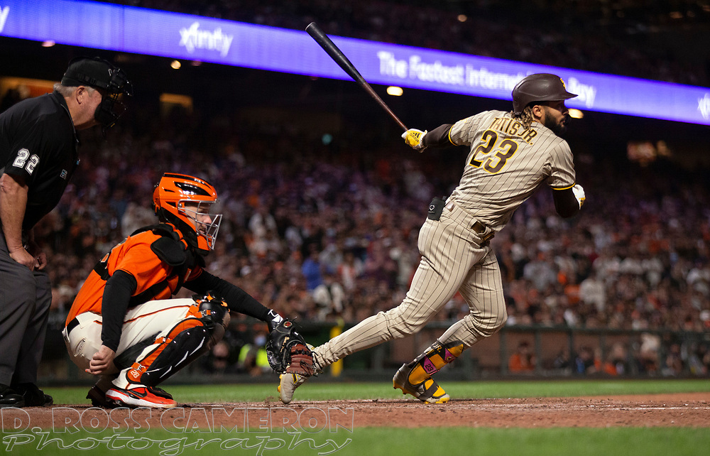 Oct 1, 2021; San Francisco, California, USA; San Diego Padres shortstop Fernando Tatis Jr. (23) follows through on his double against the San Francisco Giants during the eighth inning at Oracle Park. Mandatory Credit: D. Ross Cameron-USA TODAY Sports