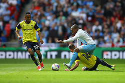 Phil Edwards of Oxford United sliding tackle on Kyel Reid of Coventry City - Photo mandatory by-line: Jason Brown/JMP -  02/04//2017 - SPORT - Football - London - Wembley Stadium - Coventry City v Oxford United - Checkatrade Trophy Final