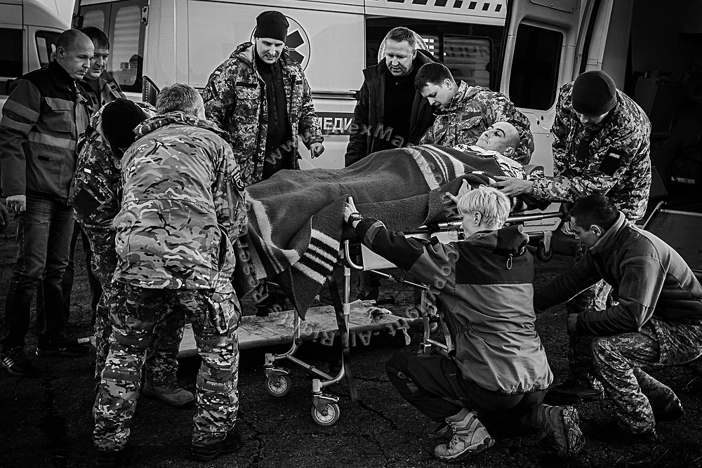 Members of the charity ASAP, 'As Soon As Possible', are evacuating a soldier wounded by shrapnel to a helicopter in Bakhmut, a town in eastern Ukraine's conflict zone, carrying him to a better equipped hospital in the city of Dnipropetrovsk.