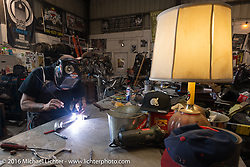 Bill Dodge welds pieces together for a new set of exhaust pipes in his Blings Cycle shop during Daytona Bike Week 75th Anniversary event. FL, USA. Friday March 4, 2016.  Photography ©2016 Michael Lichter.