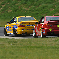 May 23, 2009; Lakeville, CT, USA; The Turner Motorsport (97) BMW M3 Coupe of Joey Hand and Chris Gleason leads the Automatic Racing (99) BMW M3 Coupe of Mark Hillestad and Barry Waddell qualify for the Grand-Am Koni Sports Car Challenge series competition during the Memorial Day Road Racing Classic weekend at Lime Rock Park.
