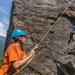 Will Tuttle belaying his brother Owen as he climbs Square Ledge in New Hampshire's White Mountains.