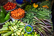 A selection of colourful Vegetables laid out on display for sale in a market on the 23rd of September 2018 in Dhaka, Bangladesh.