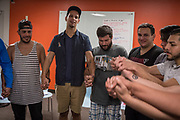 Angel Santiago holds hands with fellow members of QLatinX, a support group founded in response to the Pulse shooting with the mission of empowering LGBTQ Latinos, in Orlando, Florida, U.S.