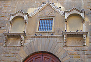 Detail from the Palazzo Vecchio. Town hall of Florence, Italy. A huge Romanesque fortress-palace overlooking the Piazza della Signoria. Designed by the architect Arnolfo di Cambio in 1299.