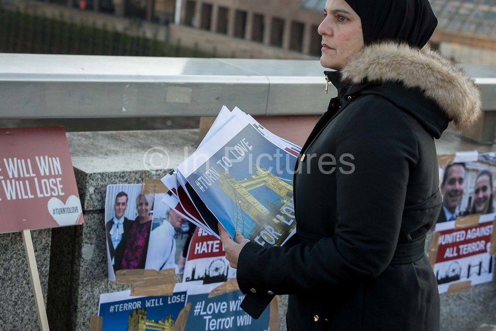 Three days after the killing of Jack Merritt, 25, and Saskia Jones, 23, by the convicted teorrorist Usman Khan at Fishmongers Hall on London Bridge, a memorial organised by the multi-faith charity Faiths Forum, appeared on the bridge showing the faces of victims and their friends, in the City of London, on 2nd December 2019, in London, England.