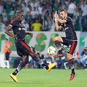 Besiktas's Oguzhan Ozyakup (R) during the Turkish soccer super league match Bursaspor between Besiktas at the Ataturk Stadium in Bursa Turkey on Monday, 22 September 2014. Photo by TURKPIX