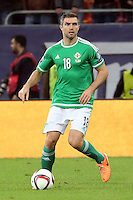 ROMANIA, Bucharest : Northern Ireland's Aaron Hughes during the Euro 2016 Group F qualifying football match Romania vs Northern Ireland in Bucharest, Romania on November 14, 2014.