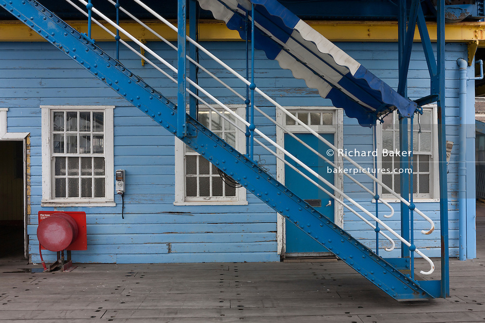 Steps on the boardwalk in the old passenger Tilbury cruise terminal, Essex.