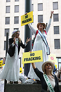 Up to a hundred women from the Lancashire anti-fracking movement dressed as suffragettes congregate in Parliament Square and pay the Dep For Energy, Business and Industrial Strategy a visit, London, Unted Kingdom, September 12 2018