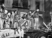 8609-A41. Students from Portland State College held a noise parade on Broadway in downtown Portland on the evening of October  23, 1952, in celebration of their homecoming weekend. The parade 'floats' consisted of two flatbed trucks and many cars. This photo shows one of the trucks with students using two pneumatic jack hammers bouncing against a steel boiler plate. Other students are hammering an iron pipe with sledgehammers and crowbars. Three steam whistles were responsible for the most ear-splitting shrieks.