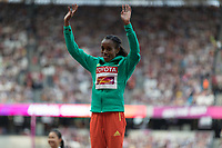 Athletics - 2017 IAAF London World Athletics Championships - Day Three, Evening Session<br /> <br /> Womens 10000m Medal Ceremony<br /> <br /> Almaz Ayana (Ethiopia) steps onto the gold medal podium and takes the applause of the crowd at the London Stadium<br /> <br /> COLORSPORT/DANIEL BEARHAM