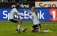 Fotball Tippeligaen Rosenborg - Viking<br /> 29 mars 2014<br /> Lerkendal Stadion, Trondheim<br /> <br /> <br /> Mikael Dorsin har scoret 2-0 for Rosenborg og jubler knestående. Mikkel Mix Diskerud (V) kommer for å gratulere<br /> <br /> <br /> <br /> Foto : Arve Johnsen, Digitalsport