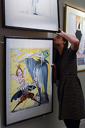 """© Licensed to London News Pictures. 31/03/2017. London, UK. A staff member inspects """"Tony Blair and the Ghost of Conservatisim"""" by Gerald Scarfe, (Est. GBP 5-7k), depicting Tony Blair and Margaret Thatcher.  Press preview of """"Made in Britain"""" at Sotheby's in New Bond Street.  The auction on 5 April celebrates innovative British art in the twentieth century as well as artwork by political cartoonist Gerald Scarfe. Photo credit : Stephen Chung/LNP"""