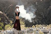 Shamanic woman raising the vibration with energy magic.