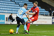 Oldham Athletic defender Brian Wilson tackles Coventry City midfielder Ryan Kent during the Sky Bet League 1 match between Coventry City and Oldham Athletic at the Ricoh Arena, Coventry, England on 19 December 2015. Photo by Alan Franklin.