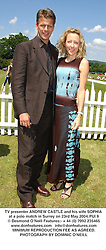 TV presenter ANDREW CASTLE and his wife SOPHIA at a polo match in Surrey on 23rd May 2004.PUI 9