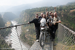Chris (L>R), Denver Joe, Bear, Corey, Grant, Sean and Kiwi Mike on the Kusma Gyadi Bridge, the tallest (443') and one of the longest (1,128') suspension bridges in the country, on Day-7 of our Himalayan Heroes adventure riding from Tatopani to Pokhara, Nepal. Monday, November 12, 2018. Photography ©2018 Michael Lichter.