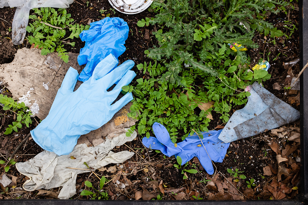 Brooklyn, NY - 31 March 2020. As social distancing, better hygiene, and other precautions become more prevalent, streets and sidewalks become increasingly littered with discarded surgical gloves and masks,, not only in commercial districts but in residential areas as well.