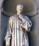Statue located outside of the Uffizi museum in Florence, Italy. One of the oldest art museums in the Western World. Semi enclosed figurative statues such as this appear all over Florence. Statue of Niccolo Macchiavelli, Italian historian, politician, diplomat, philosopher, humanist and writer based in Florence during the Renaissance.