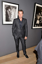 JAMES PUREFOY at a private view of photographs in aid of the Sir Hubert von Herkomer Arts Foundation held at Alon Fine Art, 5-7 Dover Street, London on 8th September 2015.