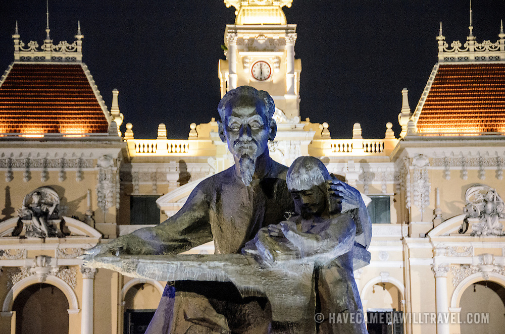Closeup of the statue of Ho Chi Minh (Uncle Ho) in front of city hall. Ho Chi Minh City Hall was built in the early 20th Century by the French colonial government as Saigon's city hall. It's also known as Ho Chi Minh City People's Committee Head office, in French as Hôtel de Ville de Saigon, and in Vietnamese as Tr? s? ?y ban Nhân dân Thành ph? H? Chí Minh.